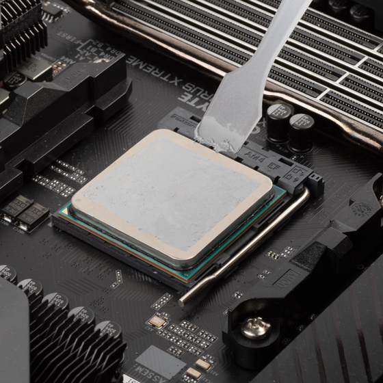 Thermal paste spread evenly using included scraper